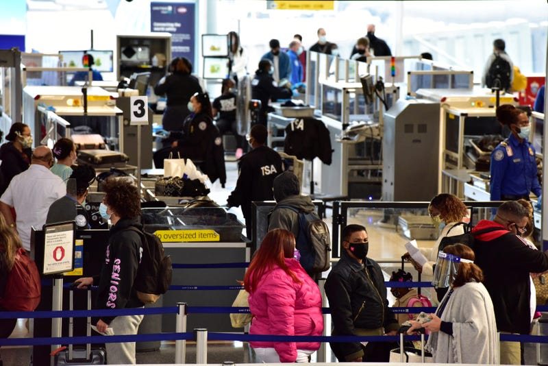 Travelers go through the TSA checkpoint at Newark Liberty Airport on the day before Thanksgiving on Wednesday Nov. 25, 2020.