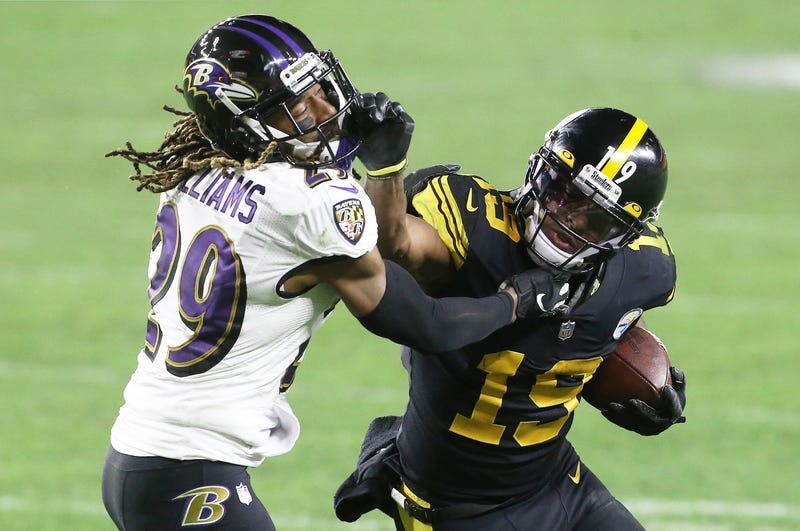 Steelers WR Juju Smith-Schuster stiff arms Ravens DB Tramon Williams during Baltimore's 19 to 14 loss to Pittsburgh
