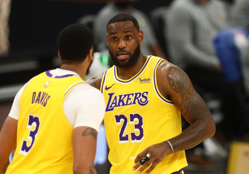 Lakers stars LeBron James and Anthony Davis on the court.