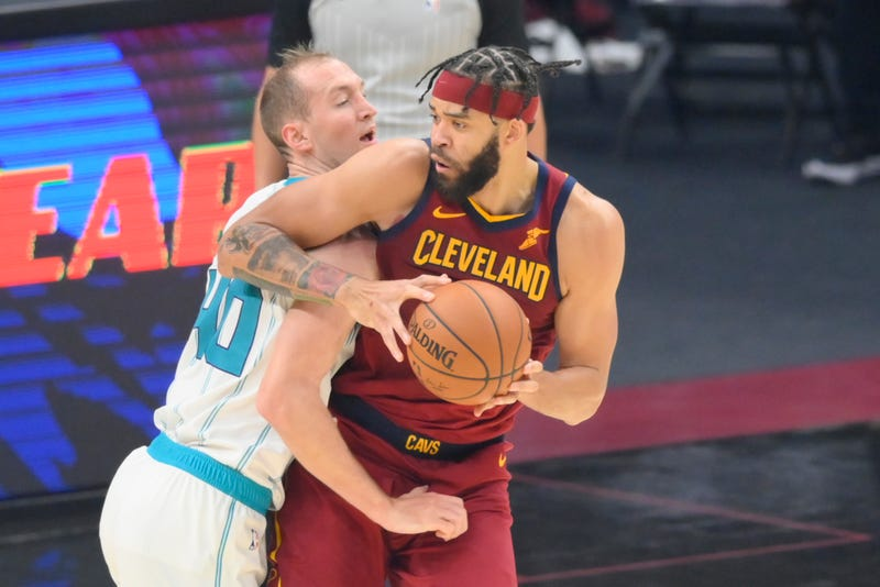 Dec 23, 2020; Cleveland, Ohio, USA; Charlotte Hornets forward Cody Zeller (40) defends Cleveland Cavaliers center JaVale McGee (6) in the second quarter at Rocket Mortgage FieldHouse.