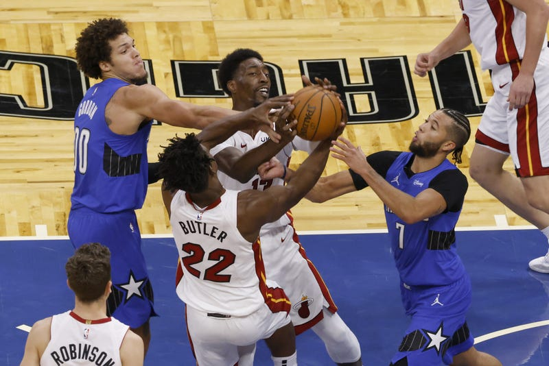 Aaron Gordon and Michael Carter-Williams battle for the ball with Bam Adebayo and Jimmy Butler