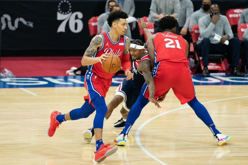 Philadelphia 76ers guard Danny Green (14) dribbles past Washington Wizards guard Bradley Beal (3) and center Joel Embiid (21) during the third quarter at Wells Fargo Center.