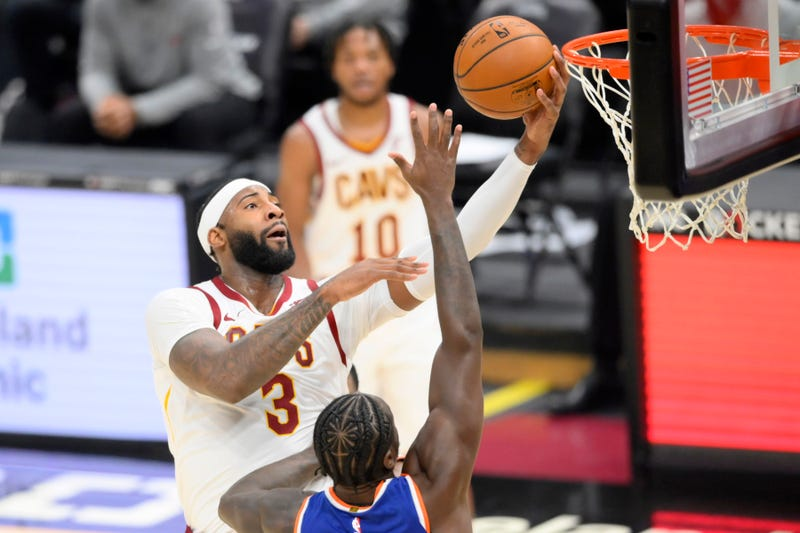 Dec 29, 2020; Cleveland, Ohio, USA; Cleveland Cavaliers center Andre Drummond (3) drives against New York Knicks forward Julius Randle (30) in the third quarter at Rocket Mortgage FieldHouse.