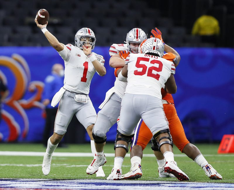 Ohio State Buckeyes quarterback Justin Fields (1) throws the ball against Clemson Tigers in the third quarter during the College Football Playoff semifinal at the Allstate Sugar Bowl in the Mercedes-Benz Superdome in New Orleans on Friday, Jan. 1, 2021.
