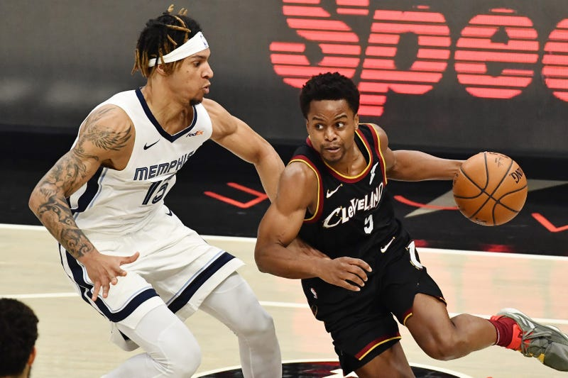 Jan 11, 2021; Cleveland, Ohio, USA; Cleveland Cavaliers guard Yogi Ferrell (5) dribbles the ball while defended by Memphis Grizzlies forward Brandon Clarke (15) during the second quarter at Rocket Mortgage FieldHouse.