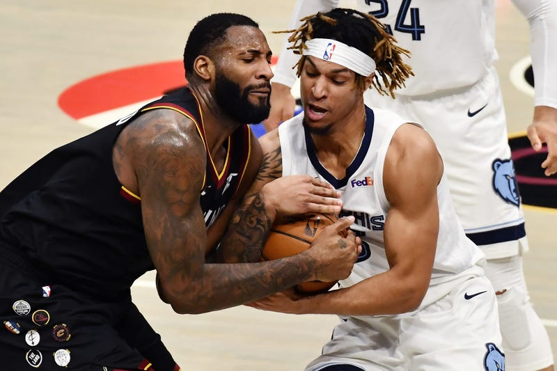 Cleveland Cavaliers center Andre Drummond (L) and Memphis Grizzlies forward Brandon Clarke (R) fight for possession during the fourth quarter at Rocket Mortgage FieldHouse.