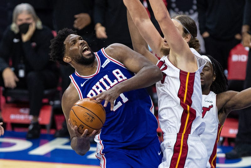 Philadelphia 76ers center Joel Embiid (21) is fouled by Miami Heat forward Kelly Olynyk (9) in overtime at Wells Fargo Center.