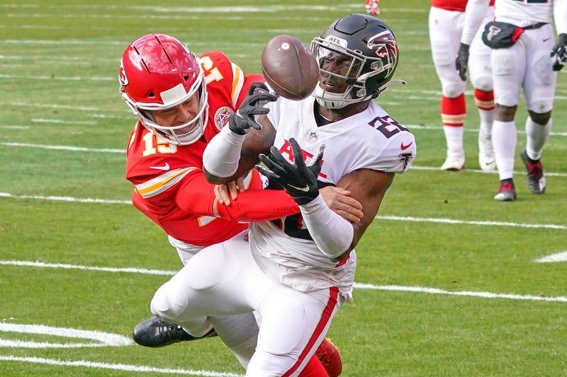 Atlanta Falcons strong safety Keanu Neal (22) intercepts a pass intended for Kansas City Chiefs quarterback Patrick Mahomes (15) during the game at Arrowhead Stadium.