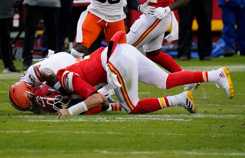 Chiefs QB Patrick Mahomes is tackled and injured by Browns LB Mack Wilson during Sunday's AFC Divisional Playoff game.