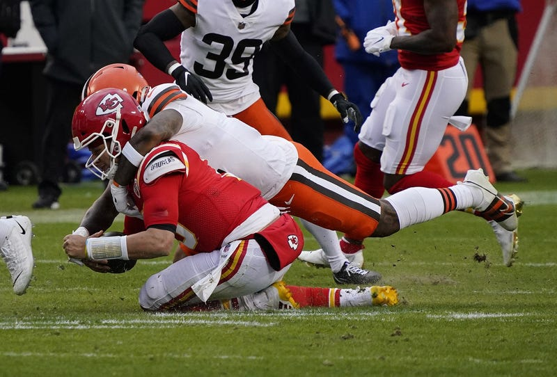 Kansas City Chiefs quarterback Patrick Mahomes (15) is brought down by Cleveland Browns outside linebacker Mack Wilson (51) during the second half in the AFC Divisional Round playoff game at Arrowhead Stadium. Mahomes would suffer an injury on the play.