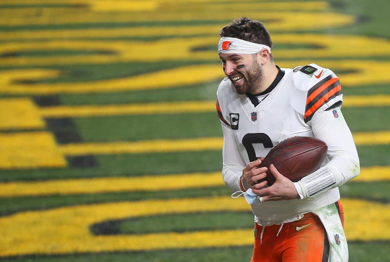 Browns quarterback Baker Mayfield (6) rushes back to the locker room after beating the Pittsburgh Steelers in an NFL wild-card playoff football game, Sunday, Jan. 10, 2021, in Pittsburgh, Pennsylvania.