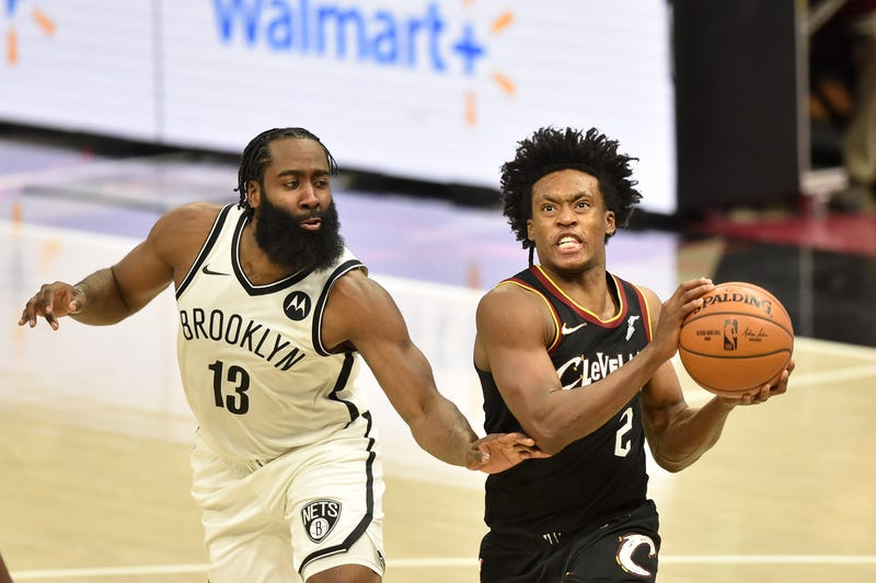 Jan 20, 2021; Cleveland, Ohio, USA; Cleveland Cavaliers guard Collin Sexton (2) drives against Brooklyn Nets guard James Harden (13) in the second overtime at Rocket Mortgage FieldHouse.