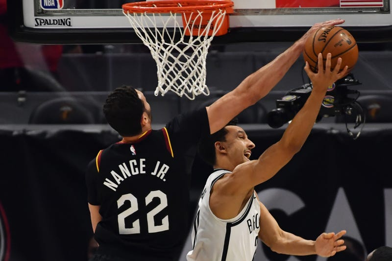 Jan 22, 2021; Cleveland, Ohio, USA; Cleveland Cavaliers forward Larry Nance Jr. (22) blocks the shot of Brooklyn Nets guard Landry Shamet (20) during the first quarter at Rocket Mortgage FieldHouse.