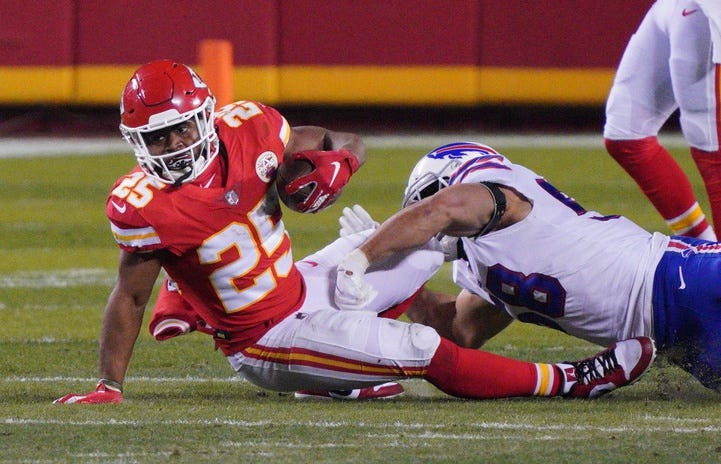 Kansas City Chiefs running back Clyde Edwards-Helaire (25) is tackled by Buffalo Bills outside linebacker Matt Milano (58) during the second quarter in the AFC Championship Game at Arrowhead Stadium.