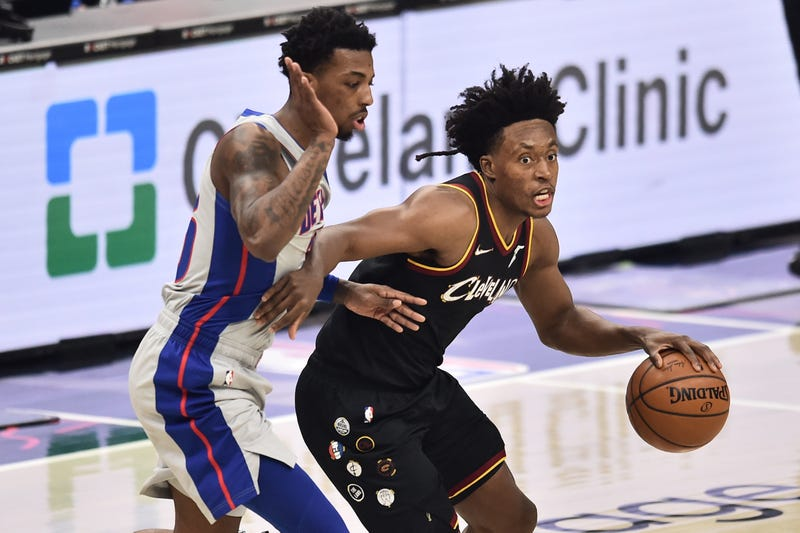 Jan 27, 2021; Cleveland, Ohio, USA; Cleveland Cavaliers guard Collin Sexton (2) dribbles against Detroit Pistons guard Delon Wright (55) during the first quarter at Rocket Mortgage FieldHouse.