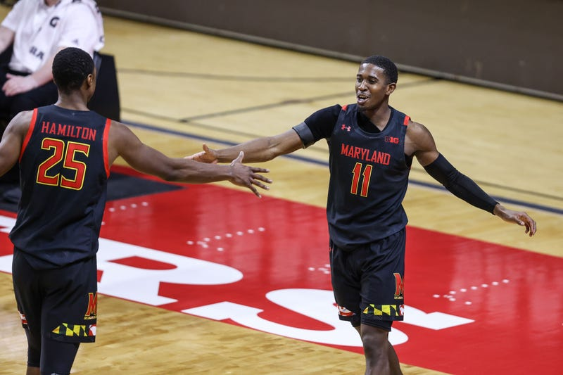 Darryl Morsell and Jarius Hamilton celebrate a big play during MD's 68-59 win over Rutgers.