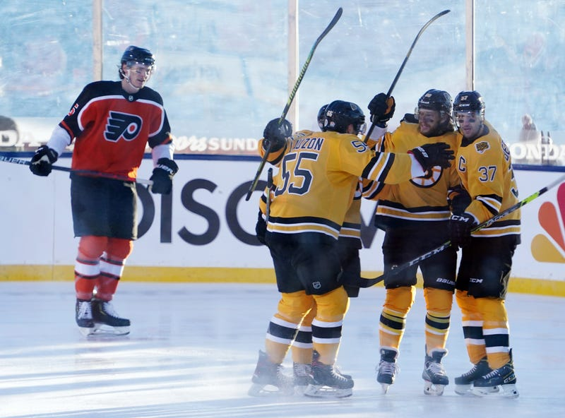 The Bruins celebrate David Pastrnak's first-period goal
