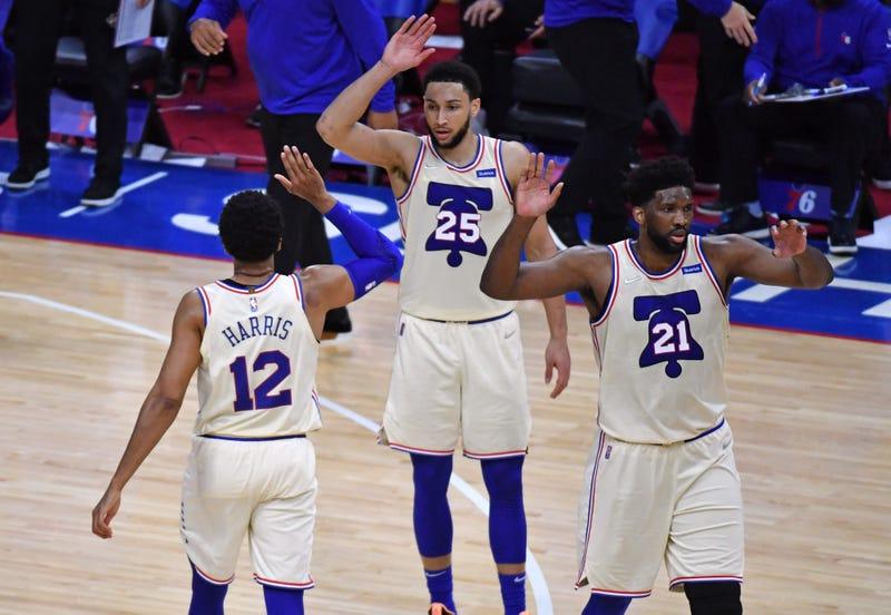 Philadelphia 76ers stars Joel Embiid, Ben Simmons, and Tobias Harris on the court.