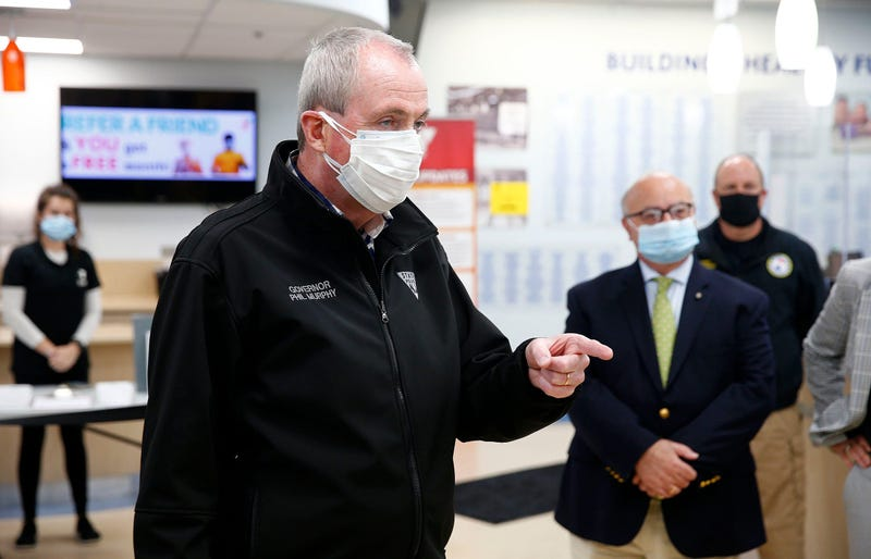 Gov. Phil Murphy speaks in the lobby of the YMCA of Greater Monmouth County in Red Bank Friday, April 16, 2021, before he toured the COVID-19 vaccination site there