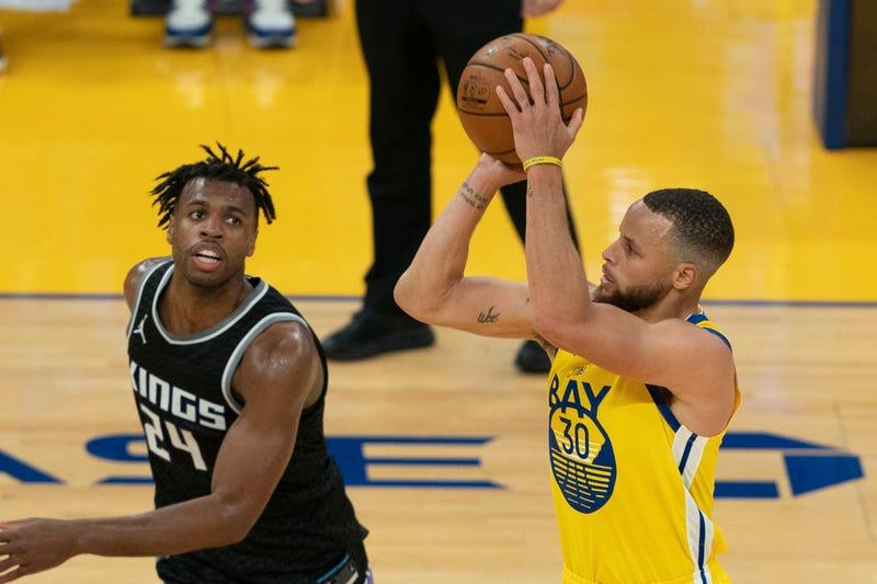 Warriors guard Stephen Curry attempts a jumpshot.
