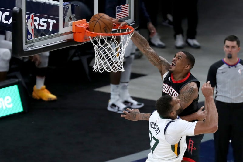 Houston Rockets forward DaQuan Jeffries (right) dunks against Utah Jazz center Rudy Gobert (27) in the fourth quarter at Vivint Arena.