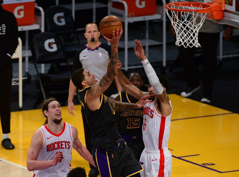 Los Angeles Lakers forward Kyle Kuzma (0) moves to the basket against Houston Rockets forward Kenyon Martin Jr. (6) during the second half at Staples Center.