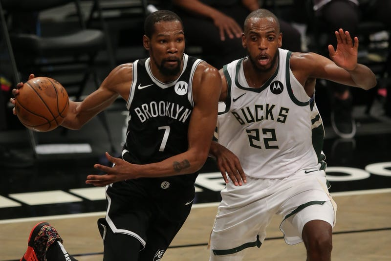 Nets star Kevin Durant guarded by Bucks star Khris Middleton.