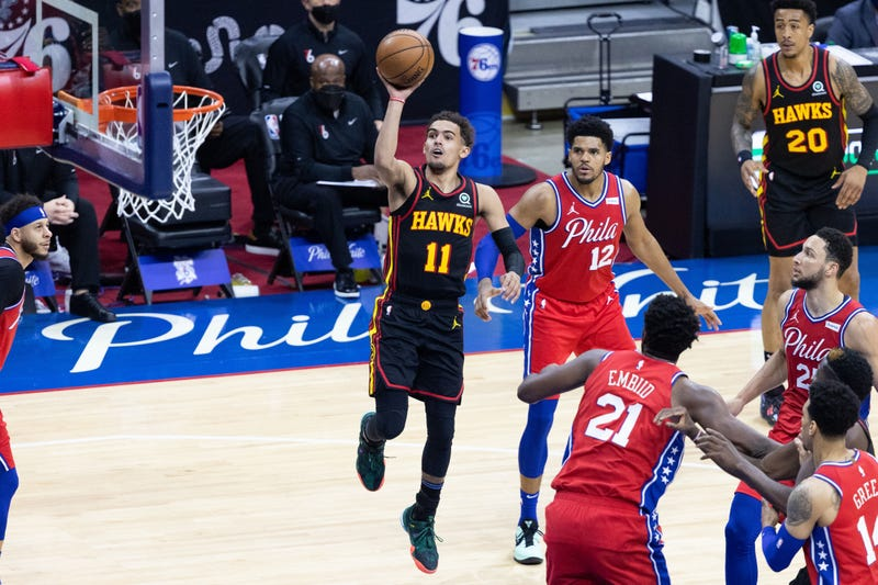 Hawks star Trae Young drives to the hoop.