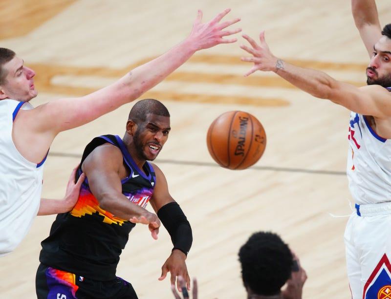 Phoenix Suns veteran Chris Paul passes the ball in traffic.