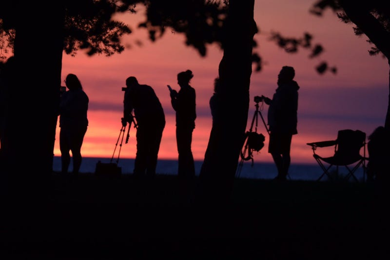 A crowd gathers at Hamlin Beach State Park in New York to watch the solar eclipse on Thursday morning