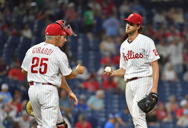 Philadelphia Phillies starting pitcher Aaron Nola and manager Joe Girardi.