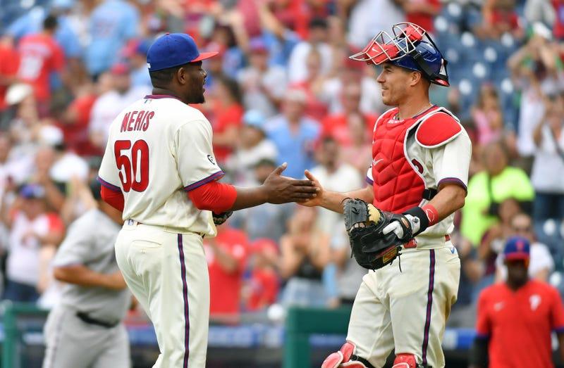 Philadelphia Phillies relief pitcher Hector Neris and Philadelphia Phillies catcher J.T. Realmuto