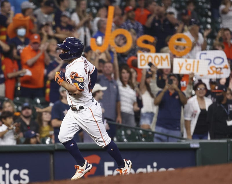 Houston Astros second baseman Jose Altuve (27) rounds the bases after hitting a home run during the third inning against the Cleveland Indians at Minute Maid Park.