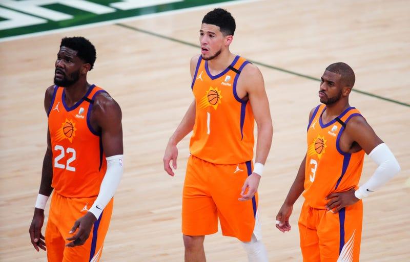 Suns stars Chris Paul, Devin Booker, and Deandre Ayton.
