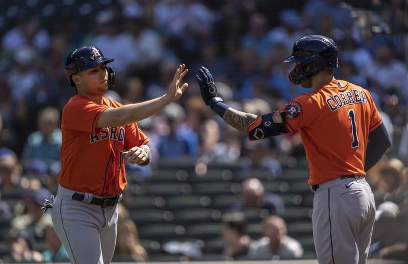Houston Astros third baseman Aledmys Diaz (16) is congratulated by shortstop Carlos Correa (1) after scoring a run on hit by first baseman Yuli Gurriel (10) during the sixth inning.