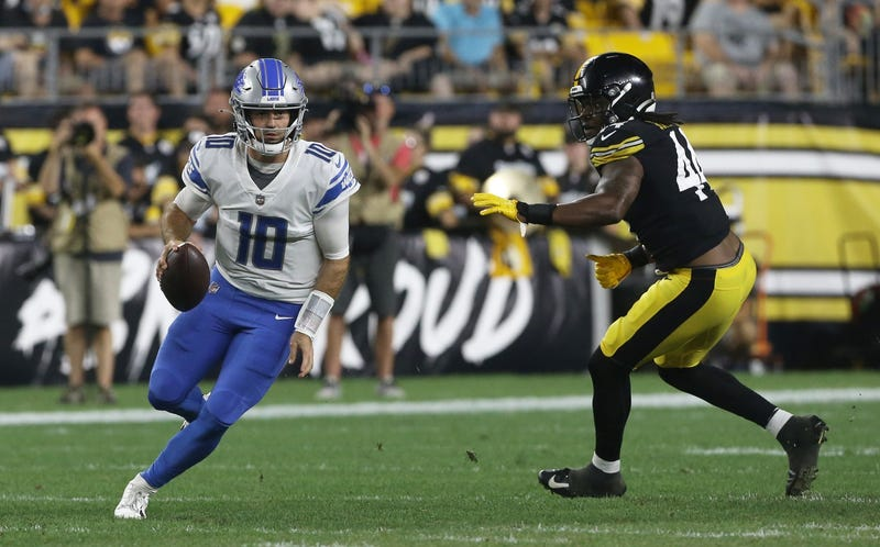 Lions quarterback David Blough (10) scrambles with the ball as Pittsburgh Steelers linebacker Jamir Jones (44) chases