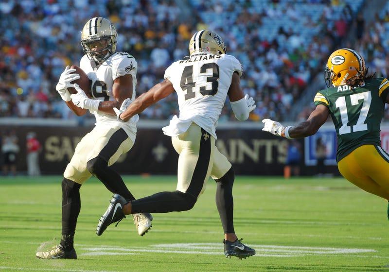 Saints cornerback Paulson Adebo intercepts Aaron Rodgers