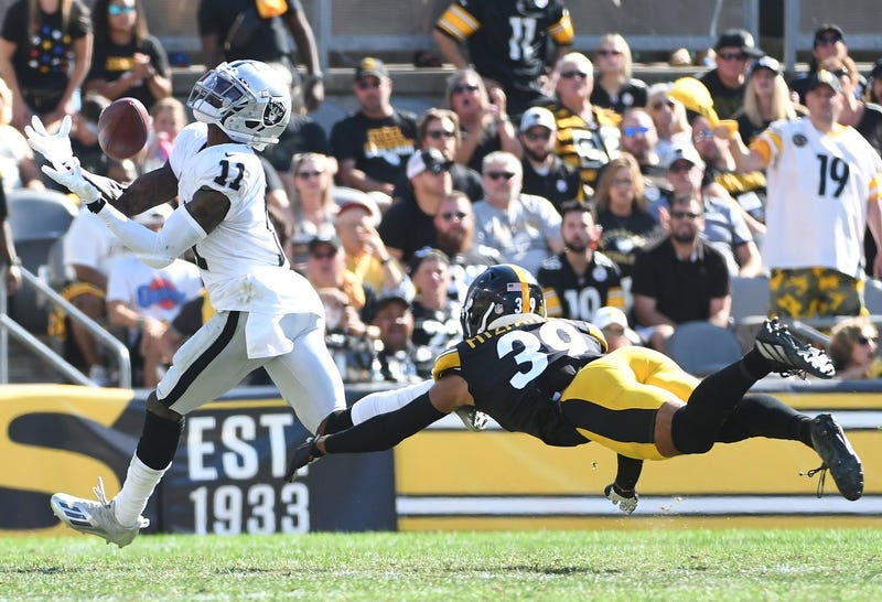 Las Vegas Raiders wide receiver Henry Ruggs III catches a pass for a 61 yard touchdown as Pittsburgh Steelers safety Minkah Fitzpatrick provides defense