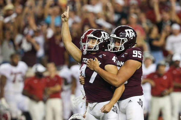 Texas A&M  punter Nik Constantinou and kicker Seth Small celebrate victory over Alabama