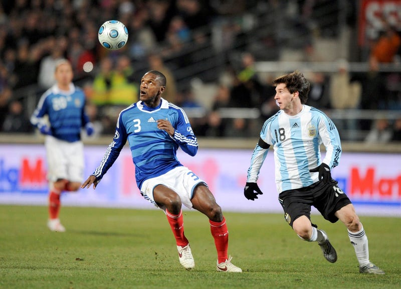 France player Eric Abidal (3) chases the ball against Argentina player Lionel Messi (18) during their World Cup qualifier match at Stade Velodrome. Argentina beat France 2-0.
