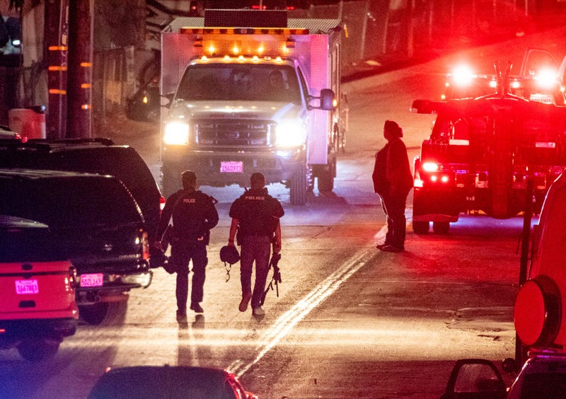 Law enforcement officers from multiple agencies continue to investigate the scene on Monday, July 29, 2019 where four people were killed and another 15 injured during the Gilroy Garlic Festival.