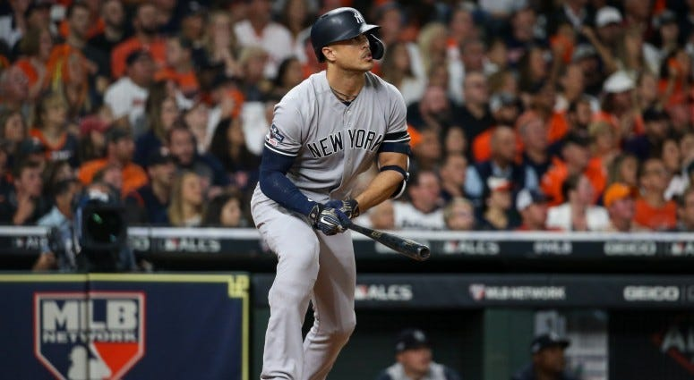 New York Yankees left fielder Giancarlo Stanton (27) hits a solo home run against the Houston Astros in the sixth inning in game one of the 2019 ALCS playoff baseball series on Oct 12, 2019 at Minute Maid Park.