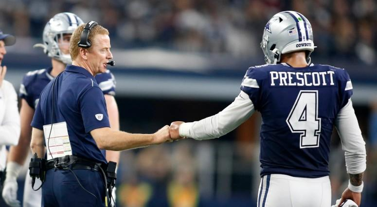 Dallas Cowboys head coach Jason Garrett congratulates quarterback Dak Prescott (4) during a time out in the game against the Los Angeles Rams on Dec 15, 2019 at AT&T Stadium.