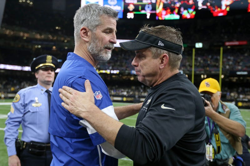 Indianapolis Colts head coach Frank Reich talks to New Orleans Saints head coach Sean Payton after their game at the Mercedes-Benz Superdome