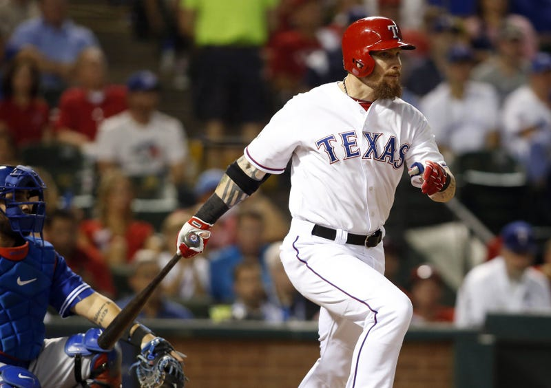 Oct 11, 2015; Arlington, TX, USA; Texas Rangers left fielder Josh Hamilton hits a single against the Toronto Blue Jays in the fifth inning in game three of the ALDS at Globe Life Park in Arlington
