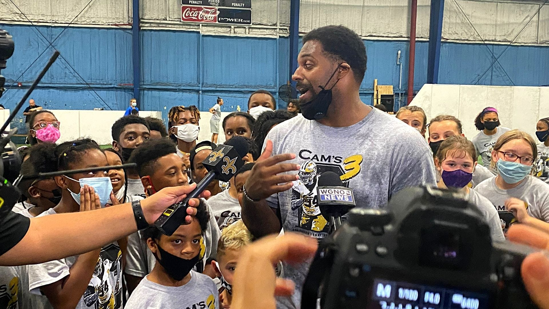 Scenes from Cam Jordan's youth camp: Football, dance breaks and Tank's debut
