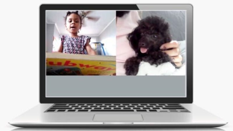 A young child reading to a puppy on Zoom