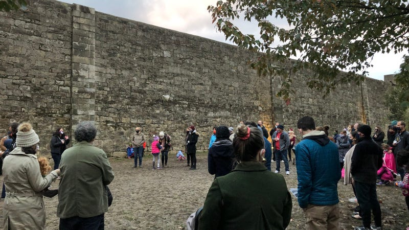 Fairmount residents hold a vigil for Walter Wallace Jr. at Eastern State Penitentiary