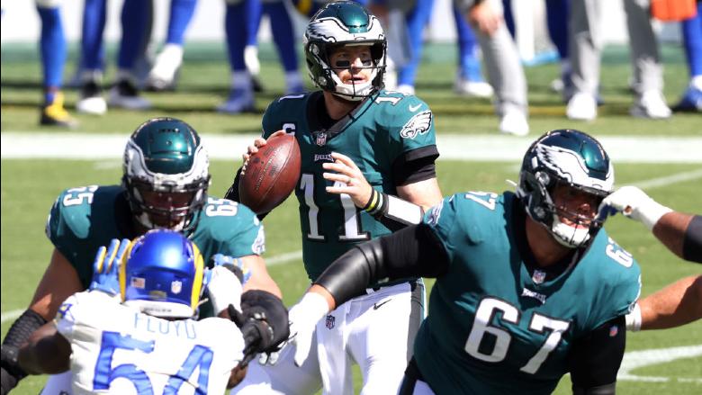 PHILADELPHIA, PENNSYLVANIA - SEPTEMBER 20: Quarterback Carson Wentz #11 of the Philadelphia Eagles throws a pass