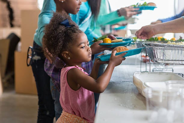 A Child Receives Nutritious Meals Thanks To Weekend Backpacks